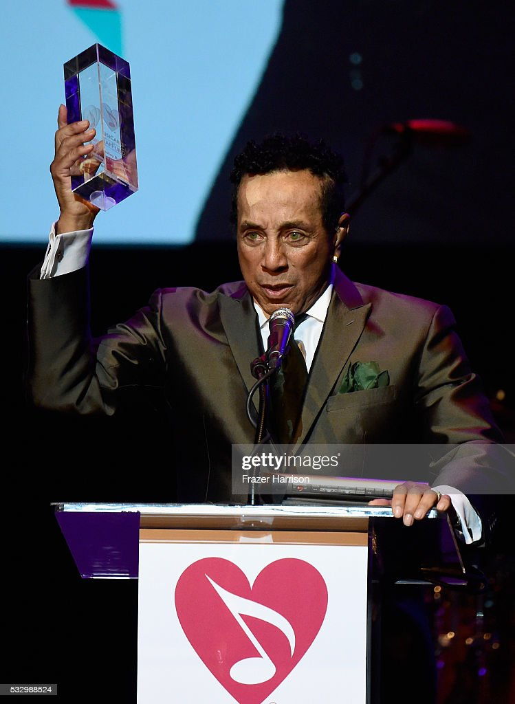 Honoree Smokey Robinson accepts the Stevie Ray Vaughan Award onstage at the 12th Annual MusiCares MAP Fund Benefit Concert Honoring Smokey Robinson at The Novo by Microsoft on May 19, 2016 in Los Angeles, California.
