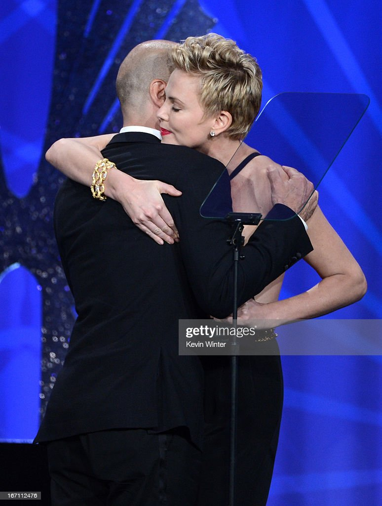 Honoree Steve Warren accepts the Stephen F. Kolzak Award from actress <a gi-track='captionPersonalityLinkClicked' href=/galleries/search?phrase=Charlize+Theron&family=editorial&specificpeople=171250 ng-click='$event.stopPropagation()'>Charlize Theron</a> onstage during the 24th Annual GLAAD Media Awards at JW Marriott Los Angeles at L.A. LIVE on April 20, 2013 in Los Angeles, California.