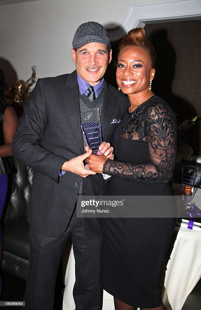 Honoree, stylist, and designer Phillip Bloch and CEO of EGAMI Consulting Group and author Teneshia Jackson Warner attend the 2012 EGAMI Consulting Group Purpose Awards at Beauty & Essex on November 13, 2012 in New York City.