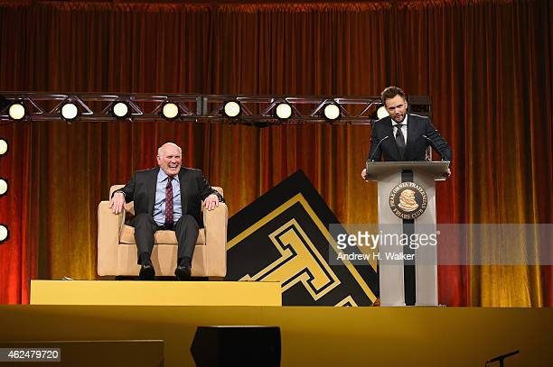Honoree Terry Bradshaw and host Joel McHale onstage at the Friars Club Roast of Terry Bradshaw during the ESPN Super Bowl Roast at the Arizona...