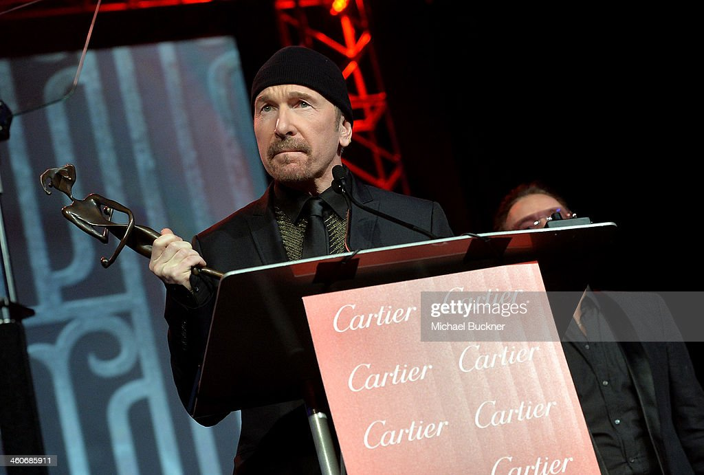 Honoree The Edge accepts the Sonny Bono Visionary award onstage during the 25th annual Palm Springs International Film Festival awards gala at Palm Springs Convention Center on January 4, 2014 in Palm Springs, California.