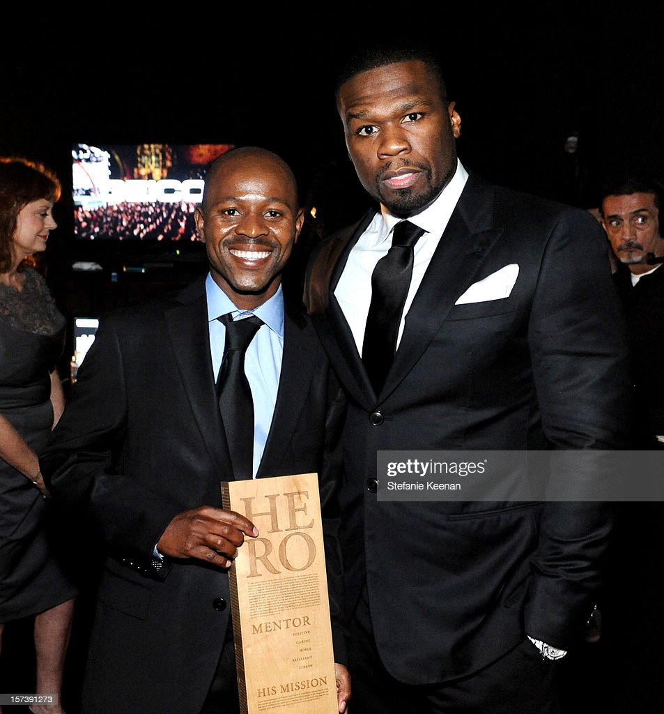 Honoree Thulani Madondo of Kliptown Youth Program and 50 Cent attend the CNN Heroes: An All Star Tribute at The Shrine Auditorium on December 2, 2012 in Los Angeles, California. 23046_005_SK_0062.JPG
