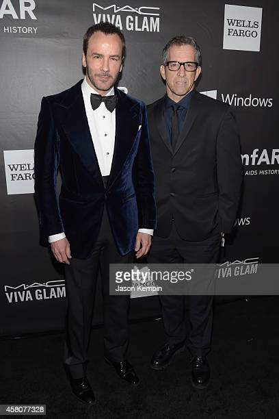 Honoree Tom Ford and amfAR Chairman Kenneth Cole attend the 2014 amfAR LA Inspiration Gala at Milk Studios on October 29 2014 in Hollywood California