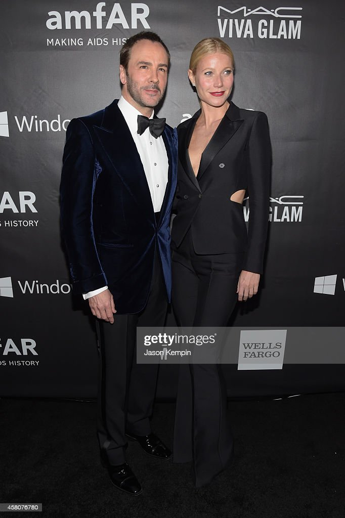 Honoree Tom Ford (L) and host Gwyneth Paltrow attend the 2014 amfAR LA Inspiration Gala at Milk Studios on October 29, 2014 in Hollywood, California.