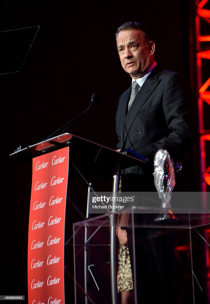 Honoree <a gi-track='captionPersonalityLinkClicked' href=/galleries/search?phrase=Tom+Hanks&family=editorial&specificpeople=201790 ng-click='$event.stopPropagation()'>Tom Hanks</a> accepts the Chairman's award onstage during the 25th annual Palm Springs International Film Festival awards gala at Palm Springs Convention Center on January 4, 2014 in Palm Springs, California.