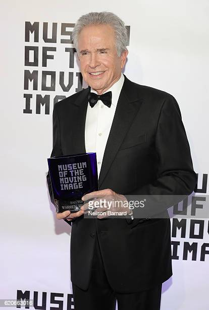 Honoree Warren Beatty poses with his award as he attends Museum Of The Moving Image 30th Annual Salute honoring Warren Beatty at 583 Park Avenue on...