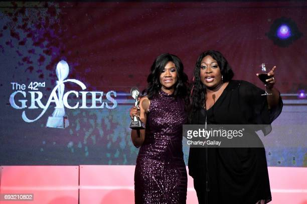 Honorees Angelique Perrin and Loni Love accept award onstage during the 42nd Annual Gracie Awards hosted by The Alliance for Women in Media at the...