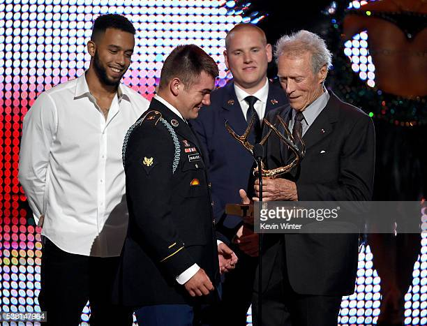 Honorees Anthony Sadler Specialist Alek Skarlatos and Airman First Class Spencer Stone accept the Hero Award from actor/director Clint Eastwood...
