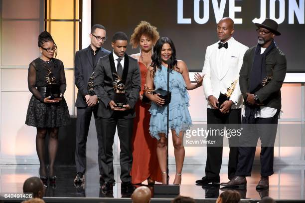Honorees Bernadette Speakes Theodore Witcher Larenz Tate Lisa Nicole Carson Nia Long Leonard Roberts and Isaiah Washington accept the Classic Cinema...