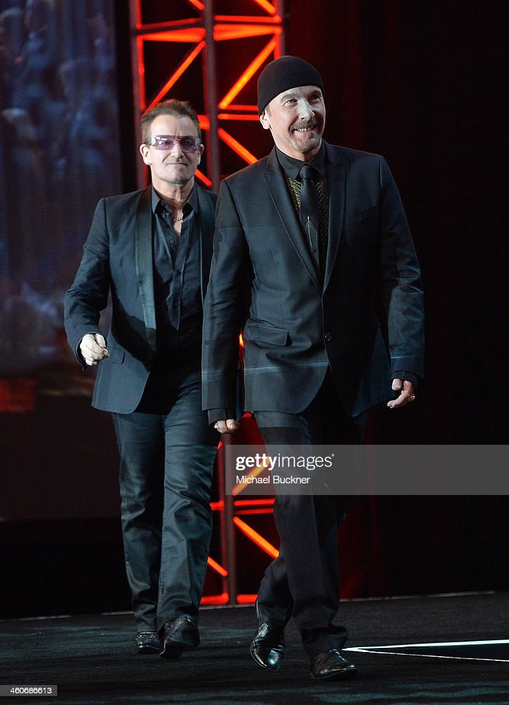 Honorees Bono and The Edge accept the Sonny Bono Visionary award onstage during the 25th annual Palm Springs International Film Festival awards gala at Palm Springs Convention Center on January 4, 2014 in Palm Springs, California.