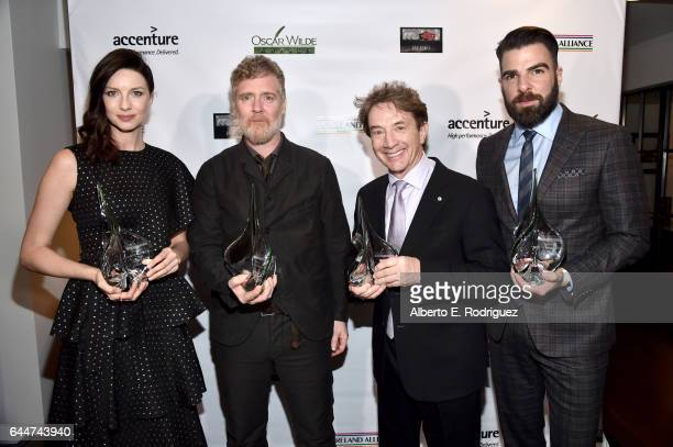 Honorees Caitriona Balfe Glen Hansard Martin Short and Zachary Quinto attend the 12th Annual USIreland Aliiance's Oscar Wilde Awards event at Bad...
