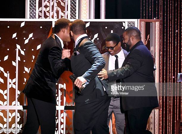 """Honorees Corey Hawkins O'Shea Jackson Jr and Jason Mitchell accept the Hollywood Breakout Ensemble Award for """"Straight Outta Compton"""" from..."""