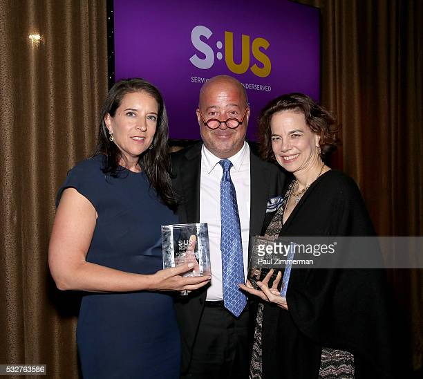 Honorees Dana Cowin chef Andrew Zimmern and Christina Grdovic pose at the Celebrity Chef Andrew Zimmern Hosts 'Dinner For A Better New York'...