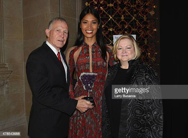 Honorees Dennis Shepard Geena Rocero and Judy Shepard pose with award at Logo's 'Trailblazer Honors' 2015 at the Cathedral of St John the Divine on...