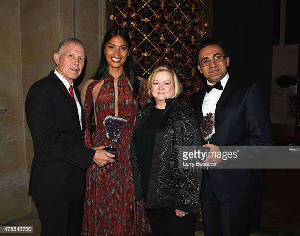 Honorees Dennis Shepard Geena Rocero Judy Shepard and Arsham Pars pose with award at Logo's 'Trailblazer Honors' 2015 at the Cathedral of St John the...