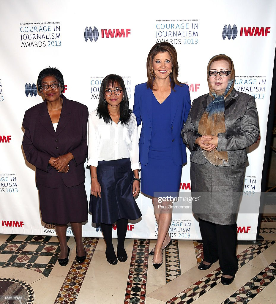 Honorees Edna Machirori, Bopha Phorn, Najiba Ayubi and (C) Journalist Norah O'Donnell attend the International Women's Media Foundation's 2013 Courage In Journalism And Lifetime Achievement Awards at Cipriani 42nd Street on October 23, 2013 in New York City.