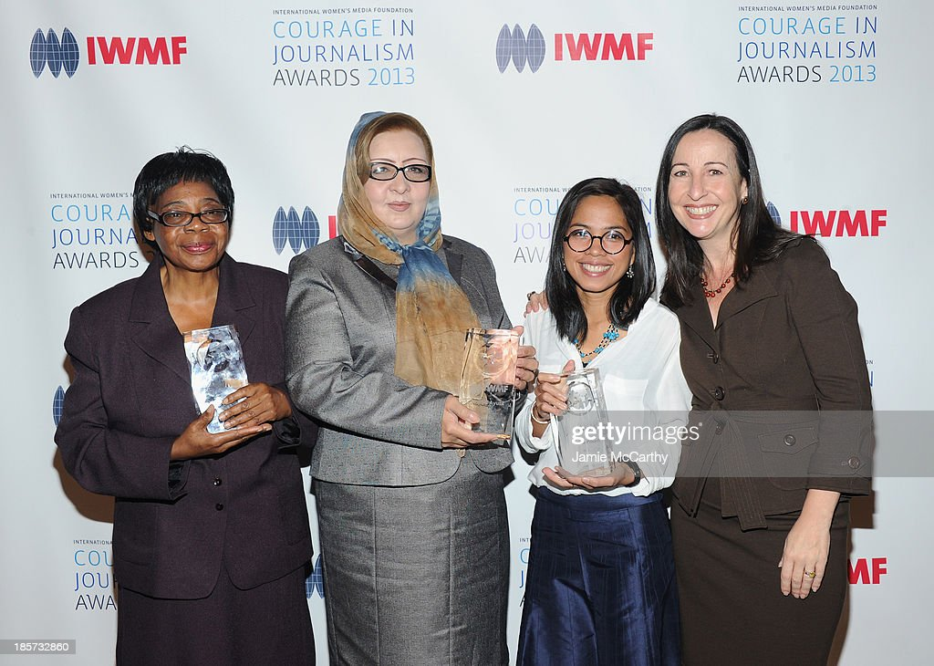 Honorees Edna Machirori, Najiba Ayubi, and Bopha Phorn, and guest attend the International Women's Media Foundation's 2013 Courage In Journalism And Lifetime Achievement Awards at Cipriani 42nd Street on October 23, 2013 in New York City.