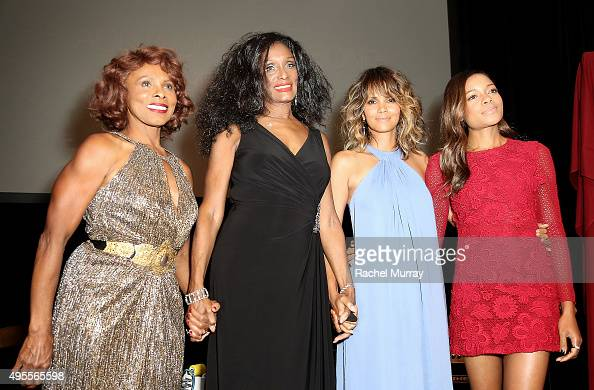 Honorees Gloria Hendry Trina Parks Halle Berry and Naomie Harris speak onstage during the Black Women of Bond Tribute at the California African...