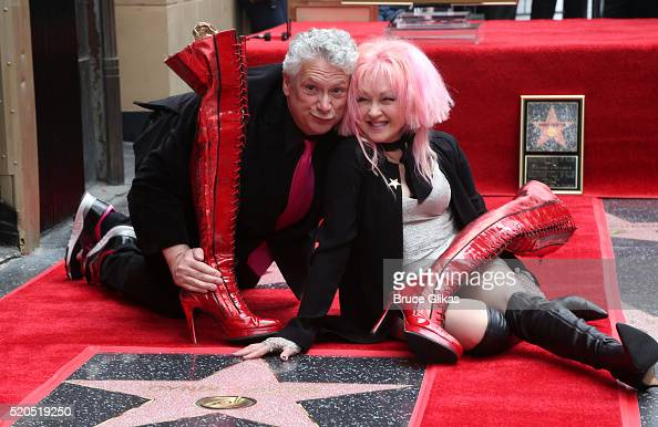 Honorees Harvey Fierstein and Cyndi Lauper pose as they are honored with Double Star Ceremony on The Hollywood Walk Of Fame on April 11 2016 in...