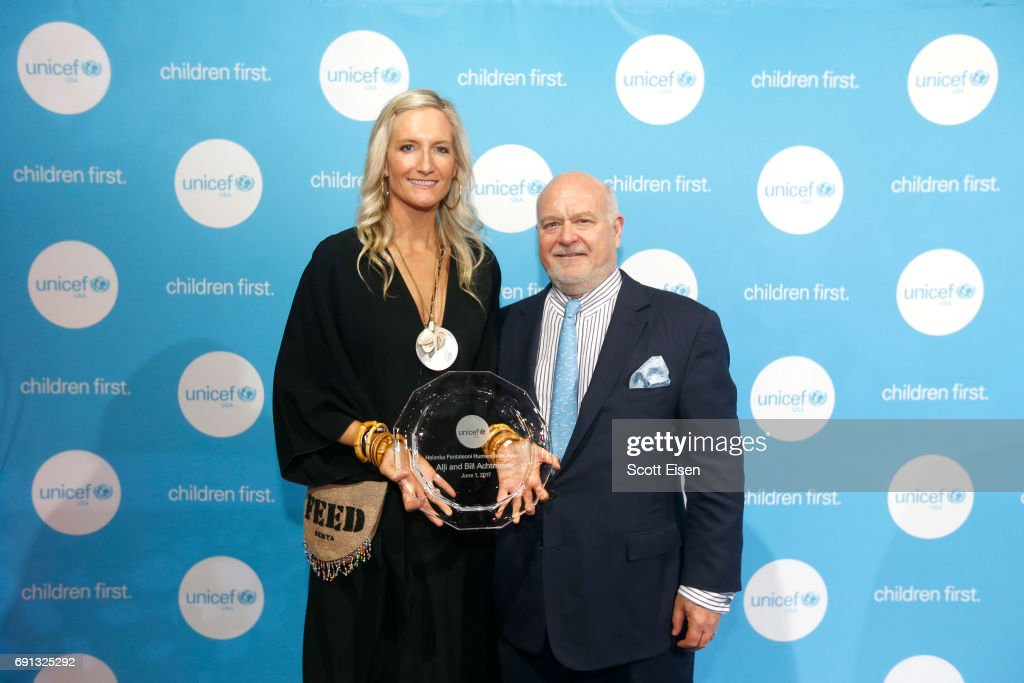 Honorees, Helenka Pantaleoni Humanitarian Award, New England Regional Board UNICEF USA Alli and Bill Achtmeyer pose for a photo with their award during UNICEF Children's Champion Award Dinner at The Castle at Park Plaza on June 1, 2017 in Boston, Massachusetts.