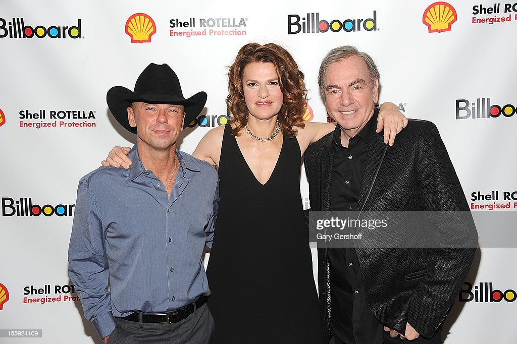 Honorees <a gi-track='captionPersonalityLinkClicked' href=/galleries/search?phrase=Kenny+Chesney&family=editorial&specificpeople=209324 ng-click='$event.stopPropagation()'>Kenny Chesney</a> (L) and <a gi-track='captionPersonalityLinkClicked' href=/galleries/search?phrase=Neil+Diamond&family=editorial&specificpeople=210635 ng-click='$event.stopPropagation()'>Neil Diamond</a> (R) with event host <a gi-track='captionPersonalityLinkClicked' href=/galleries/search?phrase=Sandra+Bernhard&family=editorial&specificpeople=204693 ng-click='$event.stopPropagation()'>Sandra Bernhard</a> attend the 2012 Billboard Touring Awards Reception at The Roosevelt Hotel on November 8, 2012 in New York City.