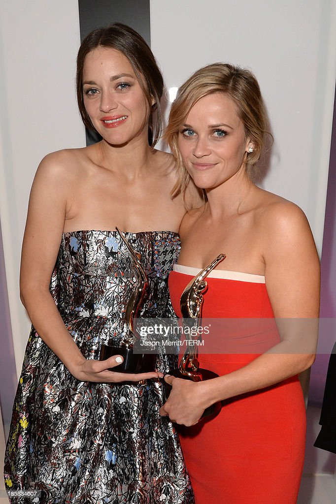 Honorees Marion Cotillard and Reese Witherspoon attend ELLE's 20th Annual Women In Hollywood Celebration at Four Seasons Hotel Los Angeles at Beverly Hills on October 21, 2013 in Beverly Hills, California.
