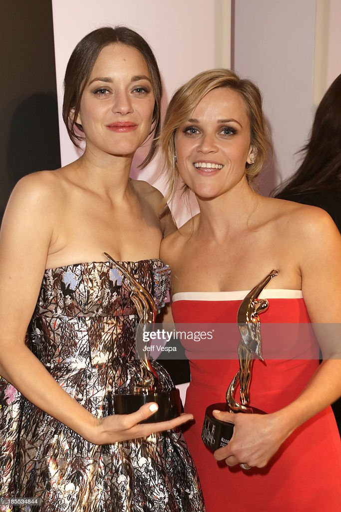 Honorees Marion Cotillard (L) and Reese Witherspoon attend ELLE's 20th Annual Women In Hollywood Celebration at Four Seasons Hotel Los Angeles at Beverly Hills on October 21, 2013 in Beverly Hills, California.