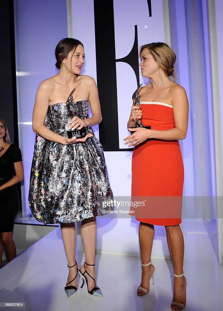 Honorees Marion Cotillard and Reese Witherspoon with award onstage at ELLE's 20th Annual Women In Hollywood Celebration at Four Seasons Hotel Los Angeles at Beverly Hills on October 21, 2013 in Beverly Hills, California.