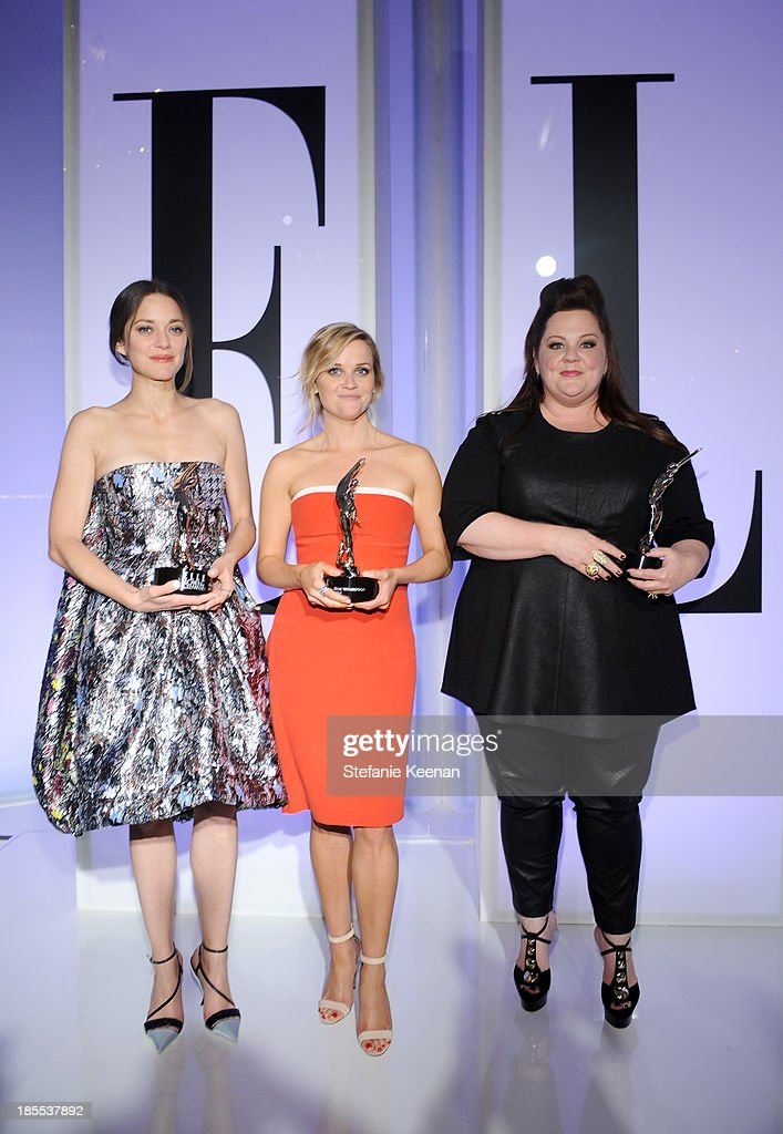 Honorees <a gi-track='captionPersonalityLinkClicked' href=/galleries/search?phrase=Marion+Cotillard&family=editorial&specificpeople=215303 ng-click='$event.stopPropagation()'>Marion Cotillard</a>, <a gi-track='captionPersonalityLinkClicked' href=/galleries/search?phrase=Reese+Witherspoon&family=editorial&specificpeople=201577 ng-click='$event.stopPropagation()'>Reese Witherspoon</a> and <a gi-track='captionPersonalityLinkClicked' href=/galleries/search?phrase=Melissa+McCarthy&family=editorial&specificpeople=880291 ng-click='$event.stopPropagation()'>Melissa McCarthy</a> pose with award onstage at ELLE's 20th Annual Women In Hollywood Celebration at Four Seasons Hotel Los Angeles at Beverly Hills on October 21, 2013 in Beverly Hills, California.