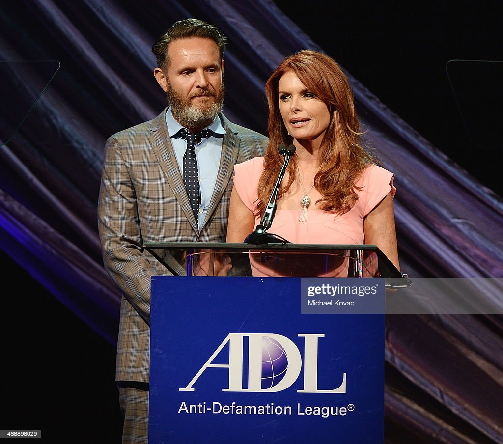 Honorees <a gi-track='captionPersonalityLinkClicked' href=/galleries/search?phrase=Mark+Burnett&family=editorial&specificpeople=204697 ng-click='$event.stopPropagation()'>Mark Burnett</a> (L) and <a gi-track='captionPersonalityLinkClicked' href=/galleries/search?phrase=Roma+Downey&family=editorial&specificpeople=214162 ng-click='$event.stopPropagation()'>Roma Downey</a> present onstage at the Anti-Defamation League Entertainment Industry Dinner at The Beverly Hilton Hotel on May 8, 2014 in Beverly Hills, California.