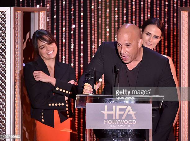 Honorees Michelle Rodriguez Vin Diesel and Jordana Brewster accept the Hollywood Blockbuster Award for 'Furious 7' onstage during the 19th Annual...