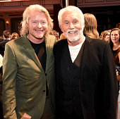 Honorees Phillip Sweet and Kenny Rogers attend the 2015 'CMT Artists of the Year' at Schermerhorn Symphony Center on December 2 2015 in Nashville...