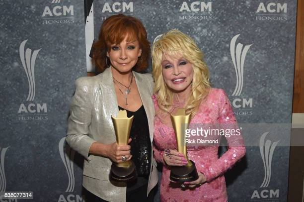 Honorees Reba McEntire and Dolly Parton attend the 11th Annual ACM Honors at the Ryman Auditorium on August 23 2017 in Nashville Tennessee