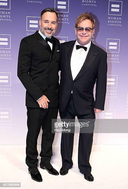 Honorees Sir Elton John and his partner David Furnish arrive at the 18th Annual HRC National Dinner at The Walter E Washington Convention Center on...