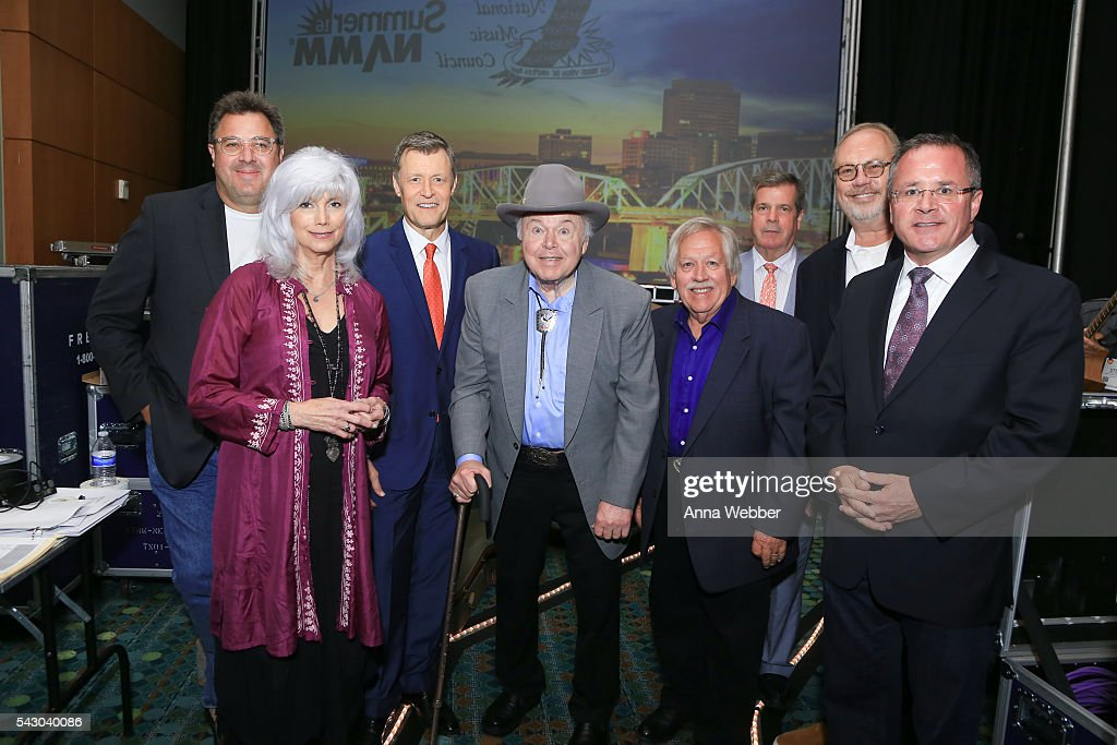 Honorees Vince Gill, EmmyLou Harris, Bill Cody, Roy Clark, John Conlee, Mayor Karl Dean, UMG Nashville Chairman/CEO Mike Dungan and Vice President/General Manager at Grand Ole Opryas Pete Fisher as seen backstage during the 33rd Annual American Eagle Awards at Music City Center on June 25, 2016 in Nashville, Tennessee.