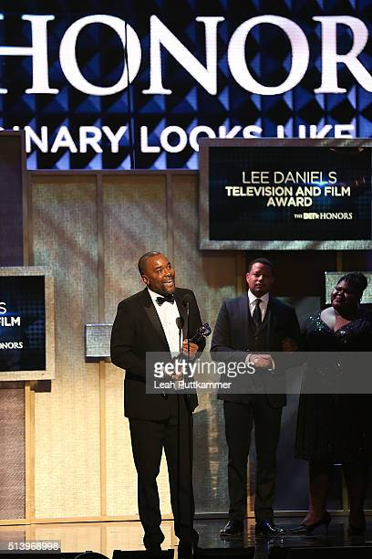 Honorree Lee Daniels accepts an award from actors Terrence Howard and Gabourey Sidibe on stage during the BET Honors 2016 at Warner Theatre on March...