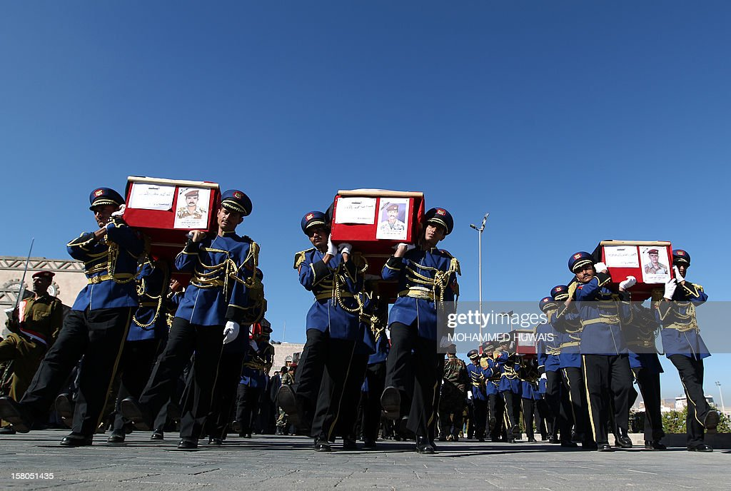 Honour guard soldiers carry the coffins of military officers during their funeral procession in Sanaa on December 10, 2012, who were killed in an ambush on December 8. Four officers were killed, including General Nasser Naji bin Farid, commander of military forces in central Yemen, and six soldiers wounded in the attack by armed men, near Marib, 140 kilometres east of Sanaa, blamed on Al-Qaeda.