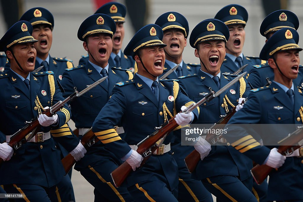 Honour guard troops march during a welcoming ceremony for visiting Palestinian President Mahmoud Abbas outside the Great Hall of the People on May 6, 2013 in Beijing, China.