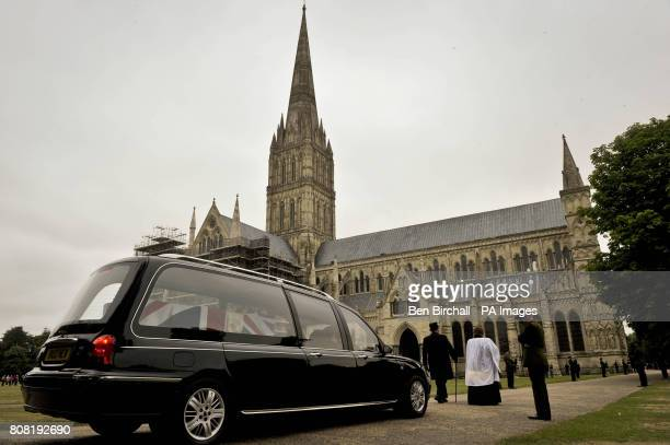 Honour Guards from the Rifles line the path leading up to Salisbury Cathedral where the Union Flag draped coffin of Major Josh Bowman passes led by...