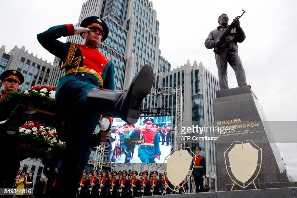 TOPSHOT Honour guards march during the unveiling ceremony of a statue of Mikhail Kalashnikov the Russian inventor of the fabled AK47 assault rifle in...
