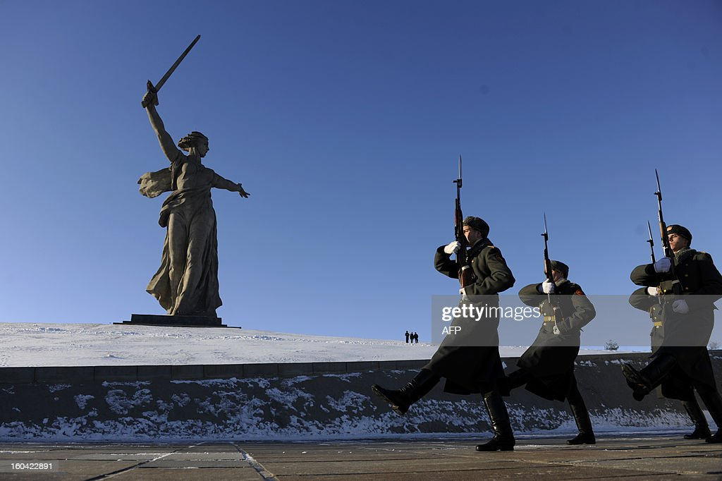 Honour guards march past the giant monument 'Rodina-Mat' zovyot!''( Mother Motherland Is Calling for Fight) also known as Mother Motherland statue, rises at the memorial on Mamayev Hill built to honour those who died in the Battle of Stalingrad during the World War II, in the Russian city of Volgograd, formerly Stalingrad, on January 31, 2013. In a new display of national pride and reminder of its status as a world power, Russia remembers this weekend the Red Army victory in the battle of Stalingrad over invading Nazi forces, one of the bloodiest battles in human history.