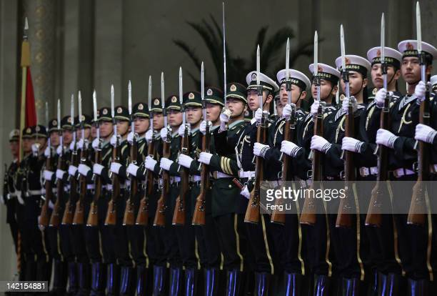 Honour guards parade before a welcoming ceremony for Italian Prime Minister Mario Monti at the Great Hall of the People on March 31 2012 in Beijing...