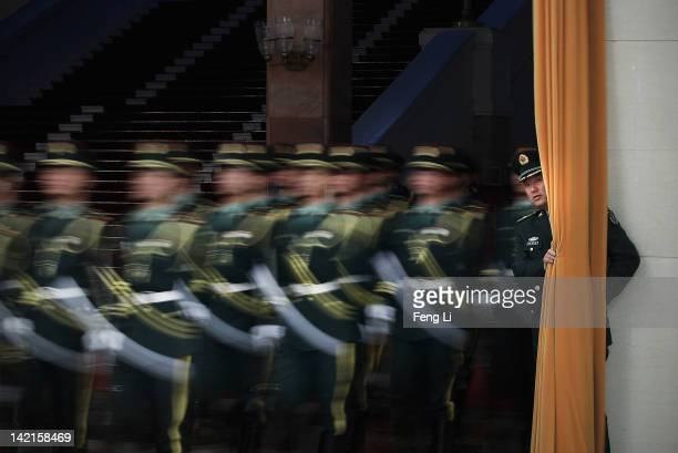 Honour guards parade before a welcoming ceremony for Prime Minister of Kazakhstan Karim Massimov at the Great Hall of the People on March 31 2012 in...
