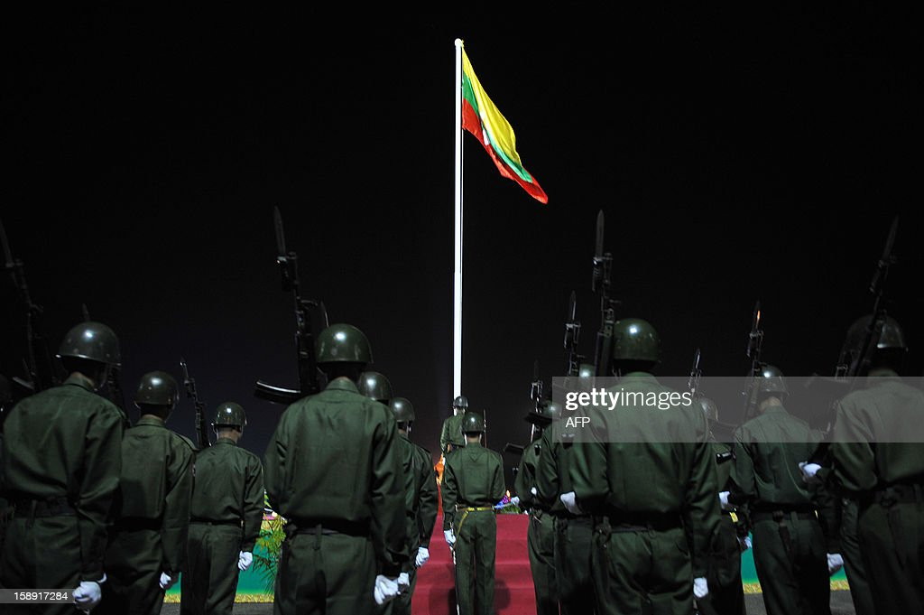 Honour guards stand to attention during a flag-raising ceremony to mark Myanmar's 65th Independence Day at the People's Square near Shwedagon pagoda in Yangon January 4, 2013. Myanmar, formerly known as Burma, gained independence from Britain on January 4, 1948.