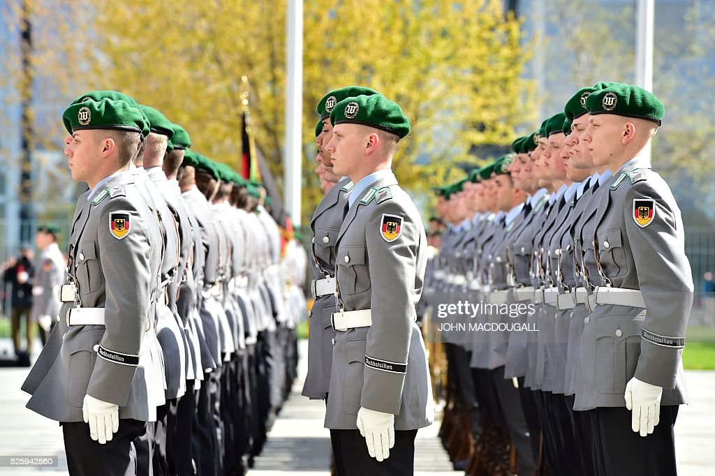 Honour guards wait lined up at the chancellery ahead of a welcoming ceremony for the Latvian Prime Minister in Berlin, on April 29, 2016. / AFP / John MACDOUGALL