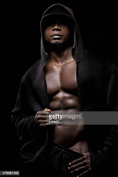 Hooded black male posing with naked torso