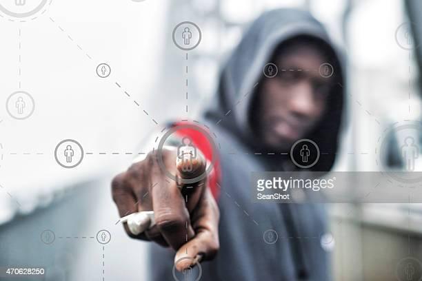 Hooded Black Man Pushing a Button