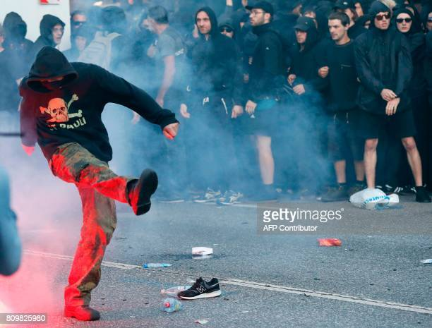 A hooded demonstrator kicks during the 'Welcome to Hell' rally against the G20 summit in Hamburg northern Germany on July 6 2017 Leaders of the...