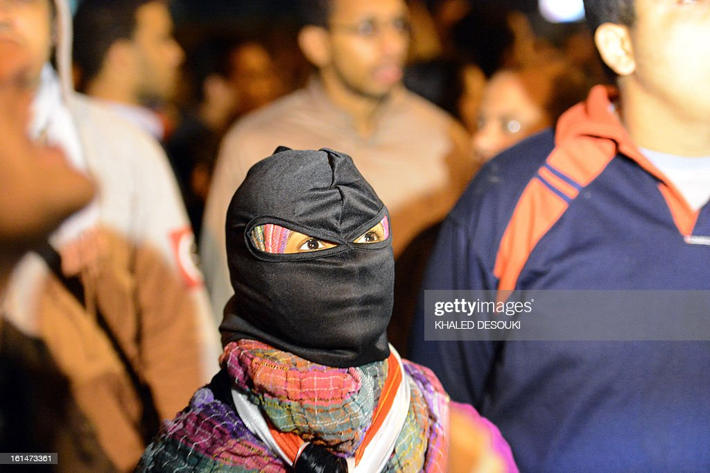 A hooded Egyptian female protester attends a demonstration in front of the presidential palace in Cairo, on February 11, 2013, during opposition held rallies to mark the second anniversary of former president Hosni Mubarak's overthrow.