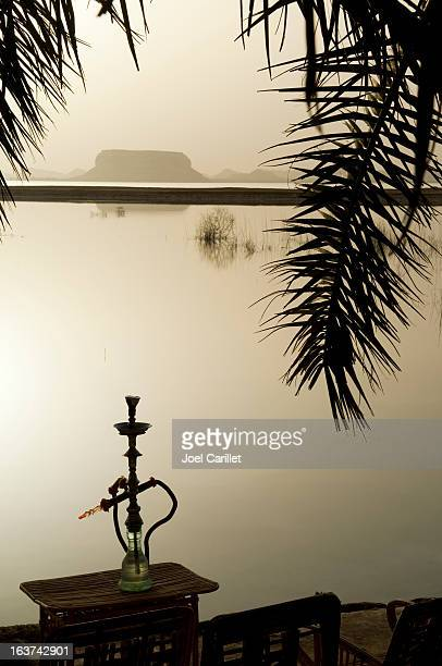 Hookah at sunset at Fatnas Spring, Siwa, Egypt